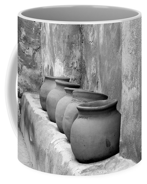 Bronstein Coffee Mug featuring the photograph The Wall Of Pots by Sandra Bronstein