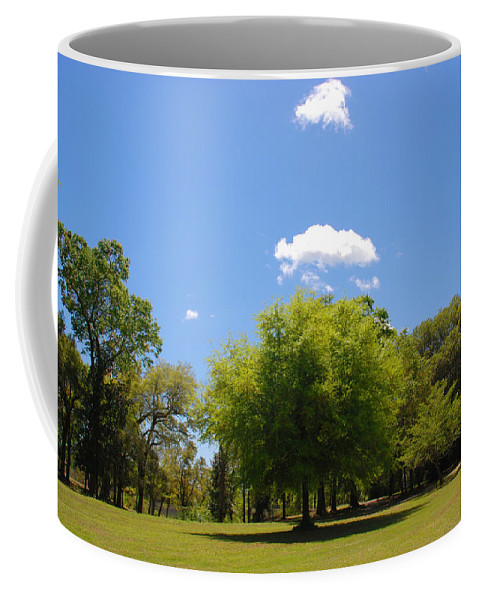 Photography Coffee Mug featuring the photograph There Are Some Clouds by Susanne Van Hulst