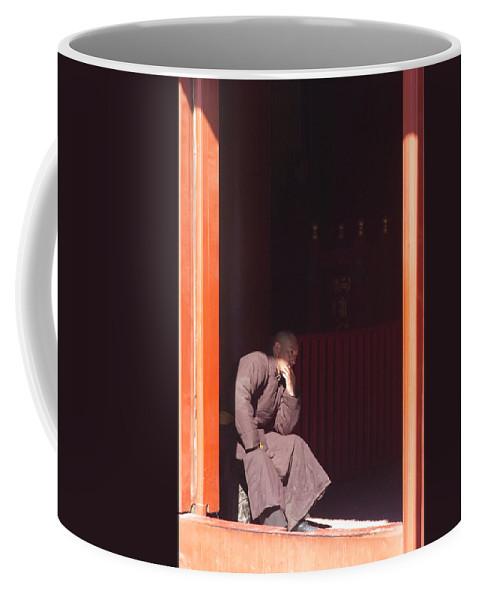 China Coffee Mug featuring the photograph Thinking Monk by Sebastian Musial