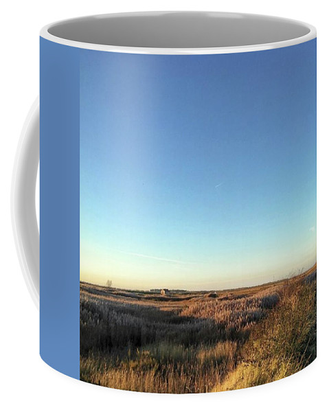 Natureonly Coffee Mug featuring the photograph Thornham Marsh Lit By The Setting Sun by John Edwards