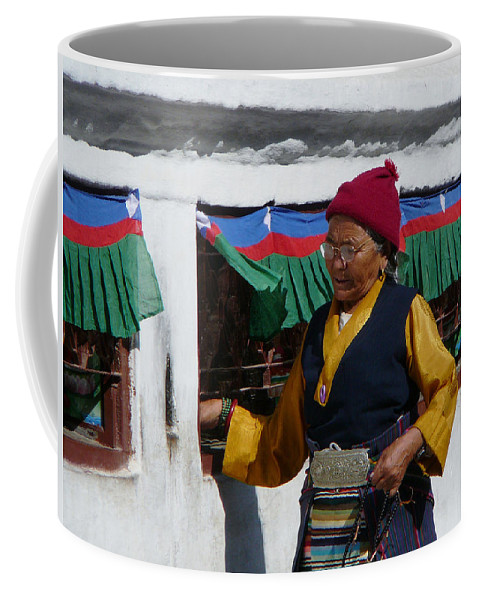 Boudanat Coffee Mug featuring the photograph Tibetan Grandmother Turning The Prayer Wheel by Dagmar Batyahav