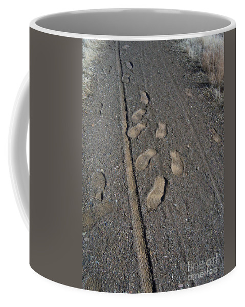 Prescott Coffee Mug featuring the photograph Tire Tracks And Foot Prints by Heather Kirk