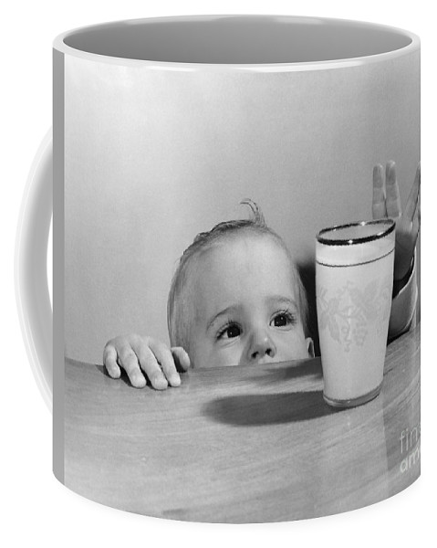 1950s Coffee Mug featuring the photograph Toddler Reaching For Glass Of Milk by O. Johnson/ClassicStock