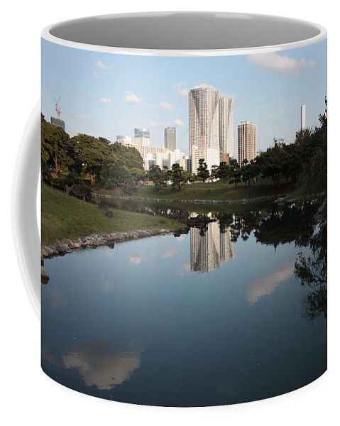 Tokyo Coffee Mug featuring the photograph Tokyo Highrises With Garden Pond by Carol Groenen