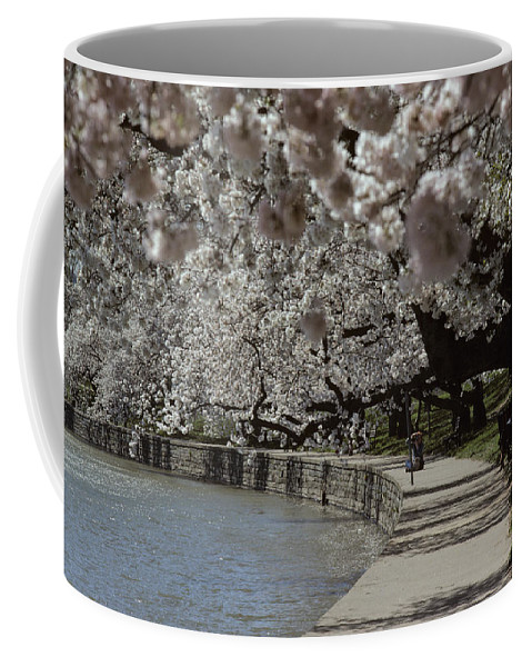 Washington Monument Coffee Mug featuring the photograph Tourists Enjoy The View At The Tidal by Kenneth Garrett