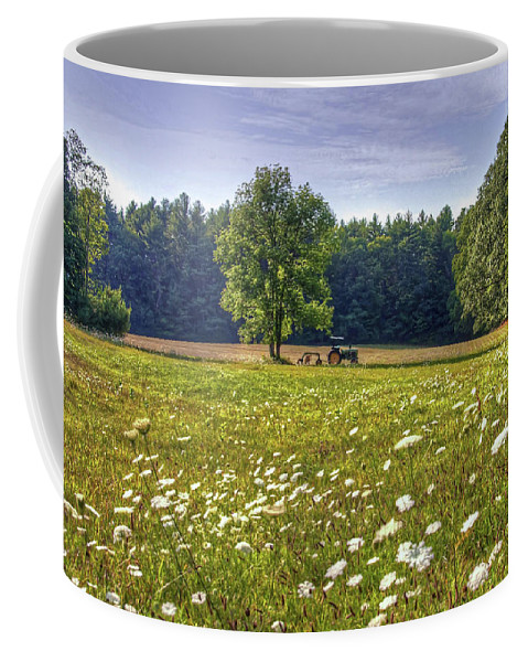 Tractor Field Flowers Trees Hay Farm Coffee Mug featuring the photograph Tractor In Field With Flowers by Wayne Marshall Chase