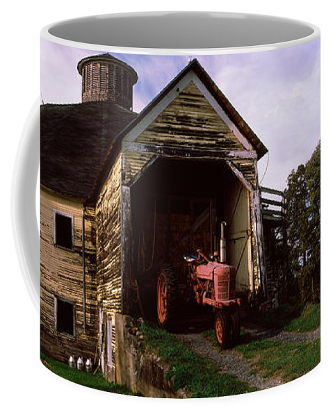Photography Coffee Mug featuring the photograph Tractor Parked Inside Of A Round Barn by Panoramic Images