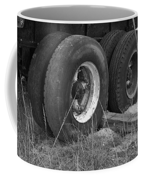Black And White Coffee Mug featuring the photograph Truck Tires by Rob Hans