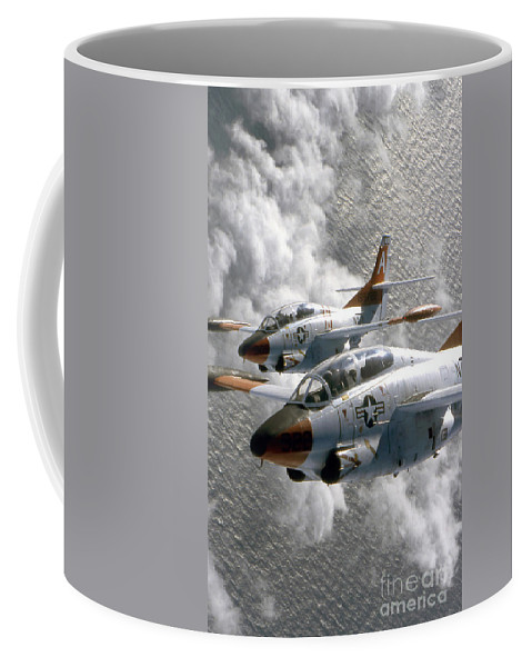 Vertical Coffee Mug featuring the photograph Two U.s. Navy T-2c Buckeye Aircraft by Stocktrek Images