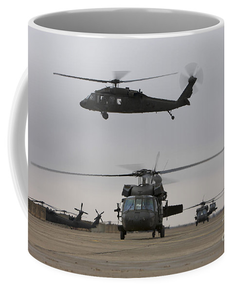 Aviation Coffee Mug featuring the photograph Uh-60 Black Hawks Taxis by Terry Moore