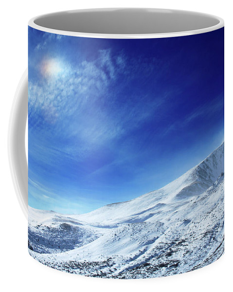 Landscape Coffee Mug featuring the photograph Under An Iridescent Sky by Brian Gustafson