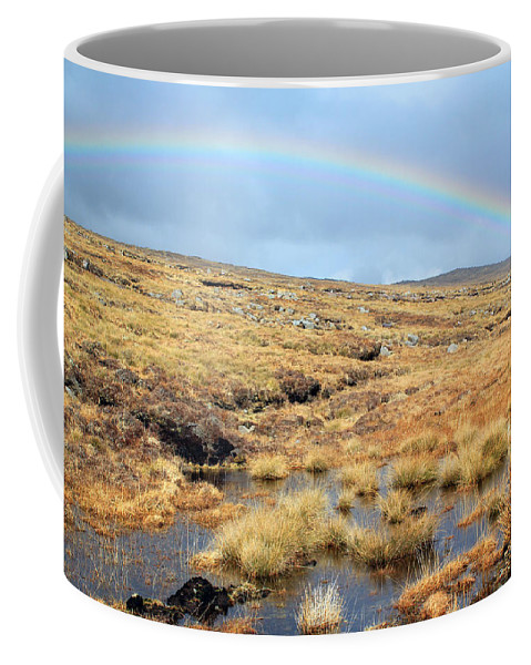 Rainbow Coffee Mug featuring the photograph Under The Rainbow by Jennifer Robin