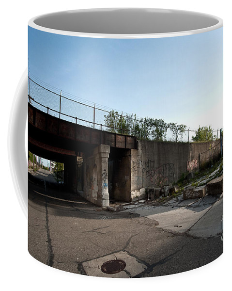 Detroit Coffee Mug featuring the photograph Under The Tracks by Steven Dunn