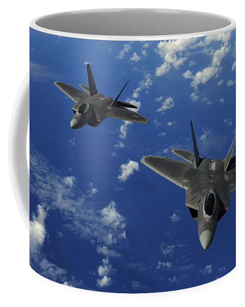 Guam Coffee Mug featuring the photograph U.s. Air Force F-22 Raptors In Flight by Stocktrek Images