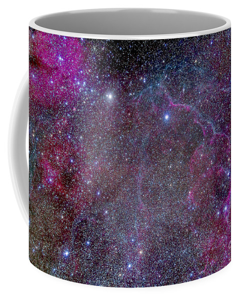 Gum 17 Coffee Mug featuring the photograph Vela Supernova Remnant In The Center by Alan Dyer