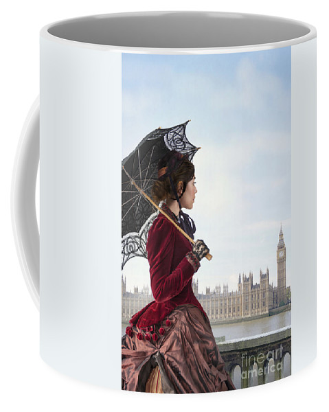 Victorian Coffee Mug featuring the photograph victorian woman with parasol in 19th century London by Lee Avison