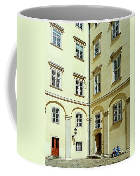 Vienna Coffee Mug featuring the photograph Vienna Courtyard Chat by Rick Shea