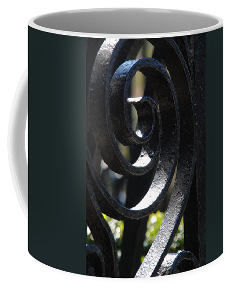 Iron Fence Coffee Mug featuring the photograph View Through The Iron Fence by Susanne Van Hulst