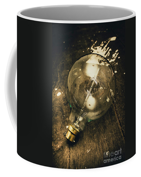 Bulb Coffee Mug featuring the photograph Vintage Light Bulb On Wooden Table by Jorgo Photography - Wall Art Gallery