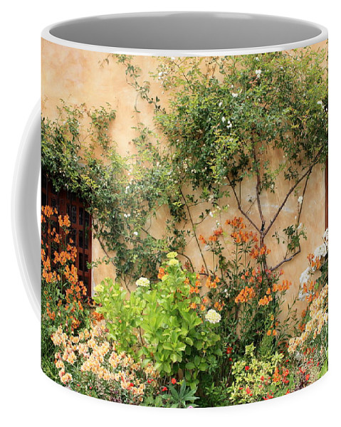 Carmel Mission Coffee Mug featuring the photograph Warm Colors In Mission Garden by Carol Groenen