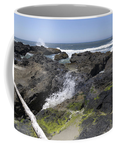 Devils Punch Bowl Coffee Mug featuring the photograph Waves Crash Ashore On A Lava Bed by John Trax