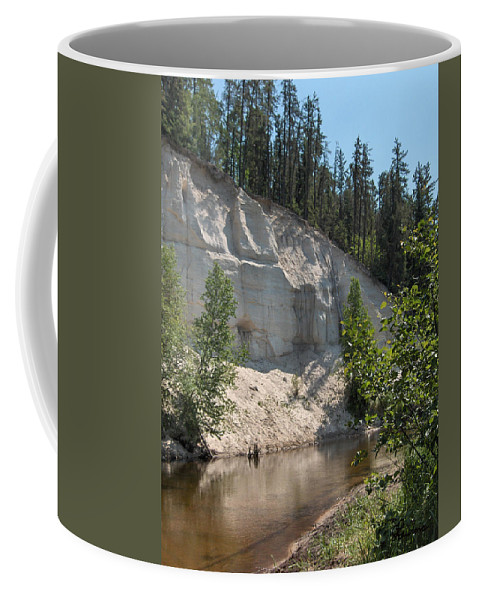 River Sand Cliffs Clear Water Evergreens Trees Natural Beauty Shore Piprell Lake Saskatchewan Coffee Mug featuring the photograph White Sands Cliff by Andrea Lawrence