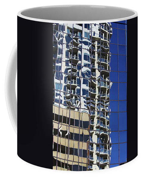 Building Coffee Mug featuring the photograph Wiggly Balconies by Phyllis Denton