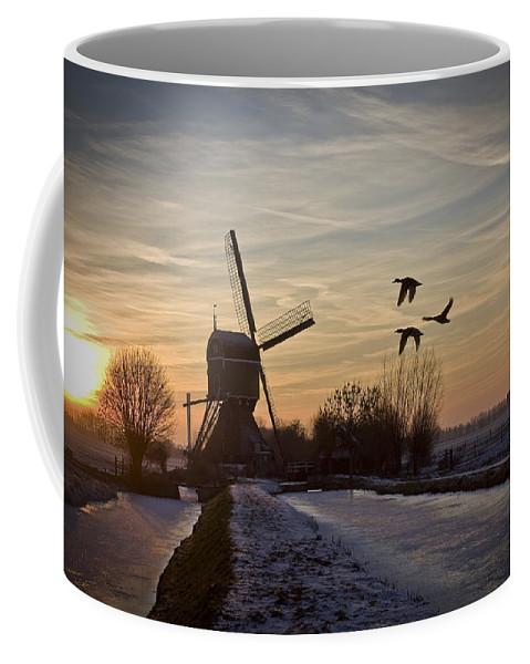 Dutch Coffee Mug featuring the photograph Winter In Holland-1 by Casper Cammeraat