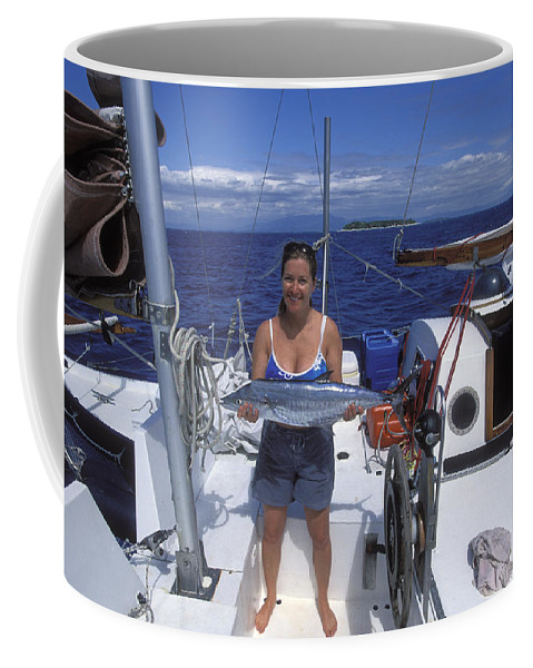 Digitally Altered Photography Coffee Mug featuring the photograph With A Spanish Mackerel Walu Caught by Rich Reid