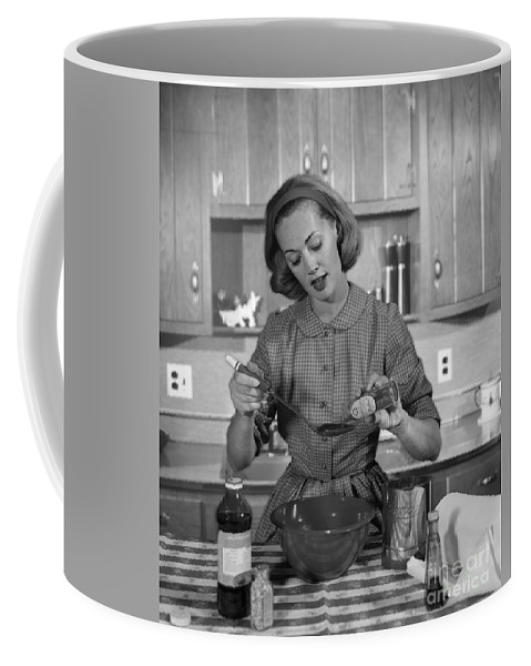 1960s Coffee Mug featuring the photograph Woman Baking In Kitchen, C.1960s by H. Armstrong Roberts/ClassicStock