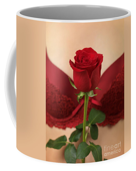 Rose Coffee Mug featuring the photograph Woman Holding A Red Rose by Oleksiy Maksymenko