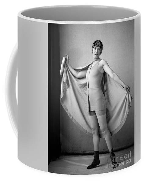 1920s Coffee Mug featuring the photograph Woman In Bathing Suit And Cape, C.1920s by H. Armstrong Roberts/ClassicStock