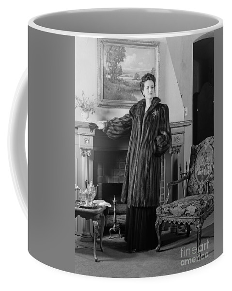 1940s Coffee Mug featuring the photograph Woman In Fur Coat, C.1940s by H. Armstrong Roberts/ClassicStock