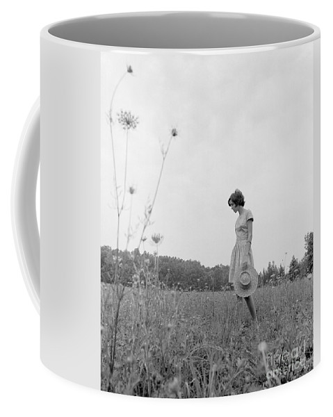 1970s Coffee Mug featuring the photograph Woman In Summer Meadow, C.1970s by H. Armstrong Roberts/ClassicStock