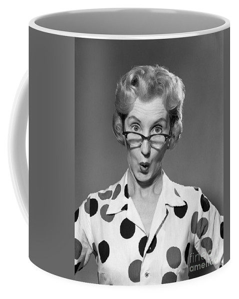 1950s Coffee Mug featuring the photograph Woman Looking Over Her Glasses by Debrocke/ClassicStock