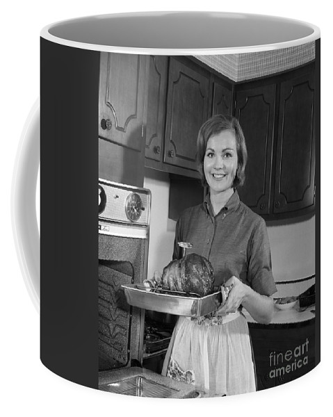 1960s Coffee Mug featuring the photograph Woman Removing Roast From Oven, C.1960s by H. Armstrong Roberts/ClassicStock