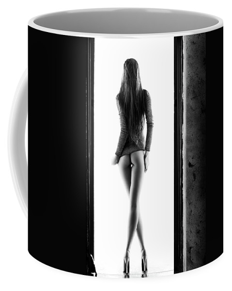 Woman Coffee Mug featuring the photograph Woman standing in doorway by Johan Swanepoel