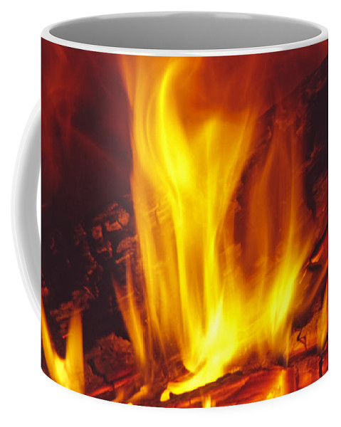 Fire Coffee Mug featuring the photograph Wood Stove - Blazing Log Fire by Steve Ohlsen