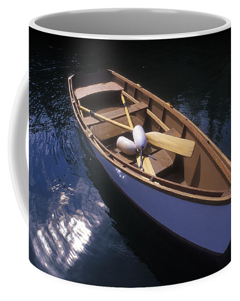 Boats Coffee Mug featuring the photograph Wooden Boat And Paddles In Halibut Cove by Rich Reid