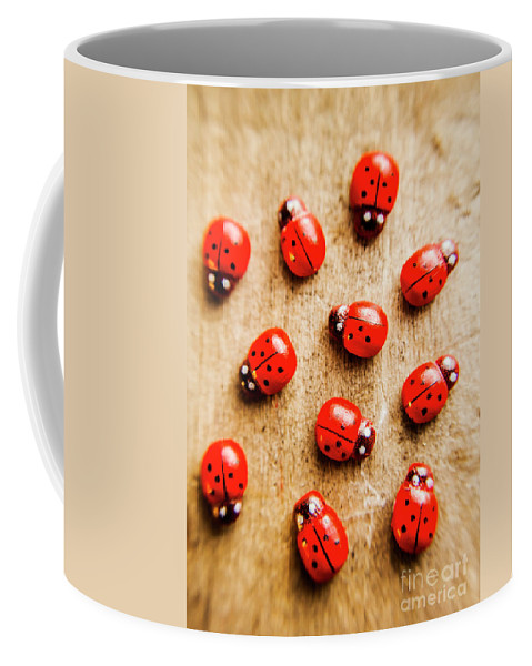 Ladybug Coffee Mug featuring the photograph Wooden Ladybugs by Jorgo Photography - Wall Art Gallery