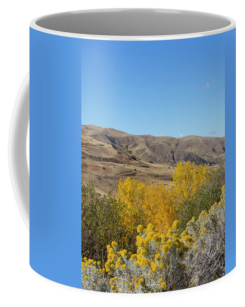 Yellow Coffee Mug featuring the photograph Yellow and Blue by Dart and Suze Humeston