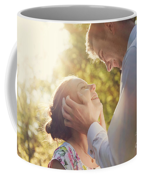 Couple Coffee Mug featuring the photograph Young Romantic Couple Flirting In Sunshine by Michal Bednarek