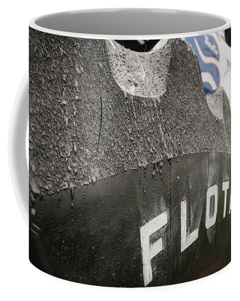 Tire Coffee Mug featuring the photograph Bigfoot's Big Foot by Jim Love