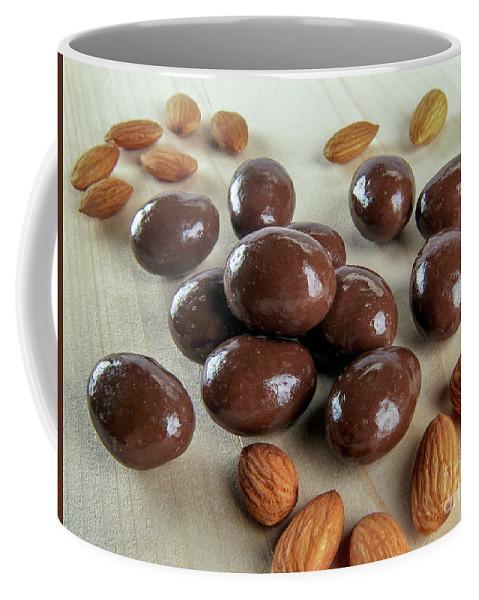 Carob Coffee Mug featuring the photograph Carob Chocolate Coated Almonds A4 by Amit Strauss