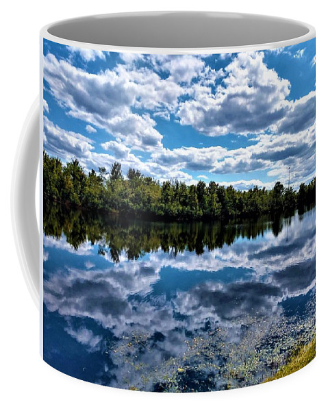 Clouds Coffee Mug featuring the photograph Cloud Reflections by Jimmy Clark