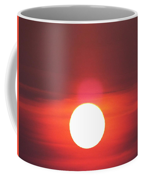 Coffee Mug featuring the photograph Crimson Sun by James Harris
