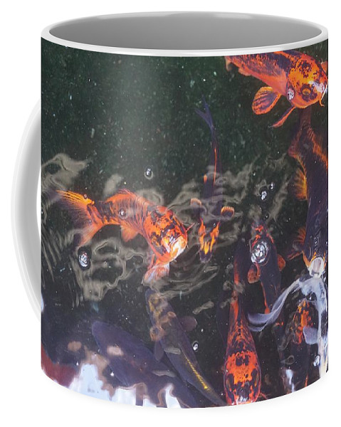 Koi Coffee Mug featuring the photograph Koi in a Pond by Jimmy Clark