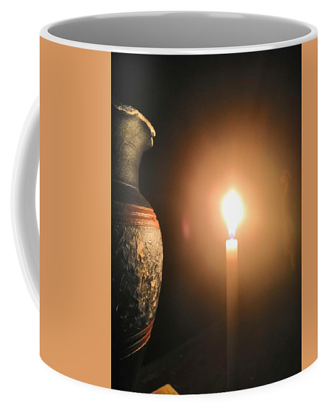Candle Light Coffee Mug featuring the photograph Light in the dark by Ian Batanda