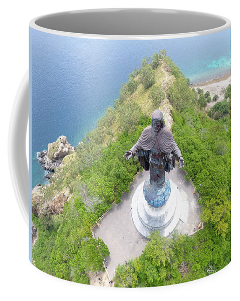 Travel Coffee Mug featuring the photograph Cristo Rei of Dili statue of Jesus by Brthrjhn2099