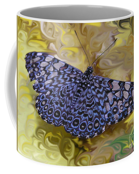 Blue Coffee Mug featuring the photograph Blue Clacker by Louise Magno